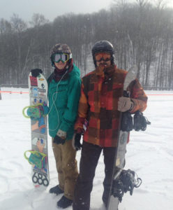 Father and son pictured with snowboards